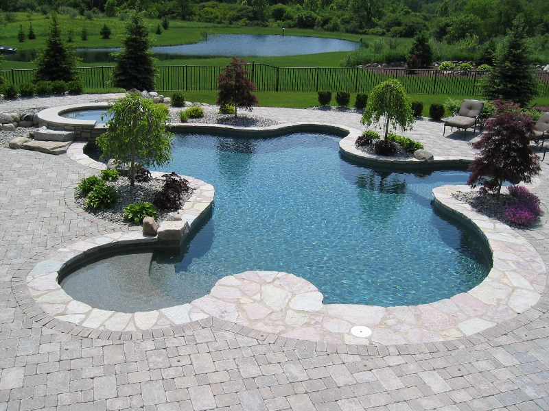 Inground pool cost hidden water pools cost for Large swimming pool designs