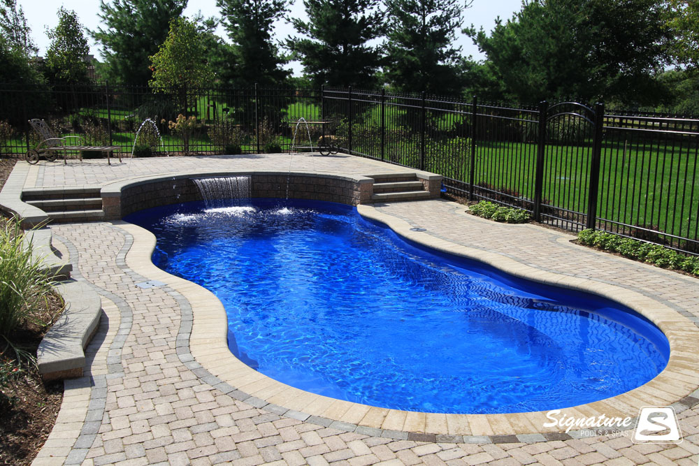 Inground pool cost hidden water pools cost for Images of inground swimming pools